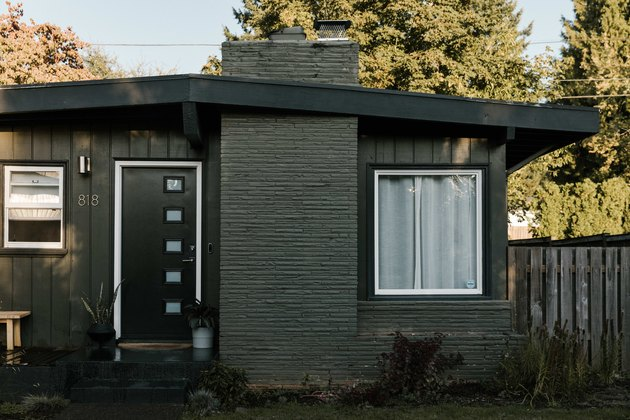 The front entrance of a midcentury ranch outside of Portland, painted black