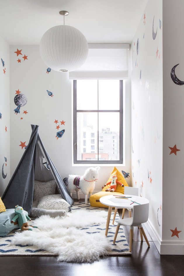 kids playroom idea with Teepee Fort in Playroom of Tribeca Loft by Chango & Co