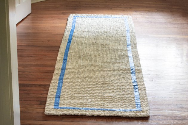 Border taped around edge of rug