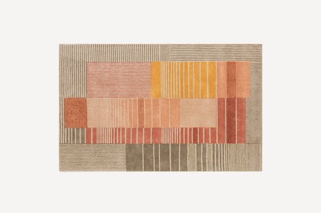 warm toned stained glass-inspired multicolored rug