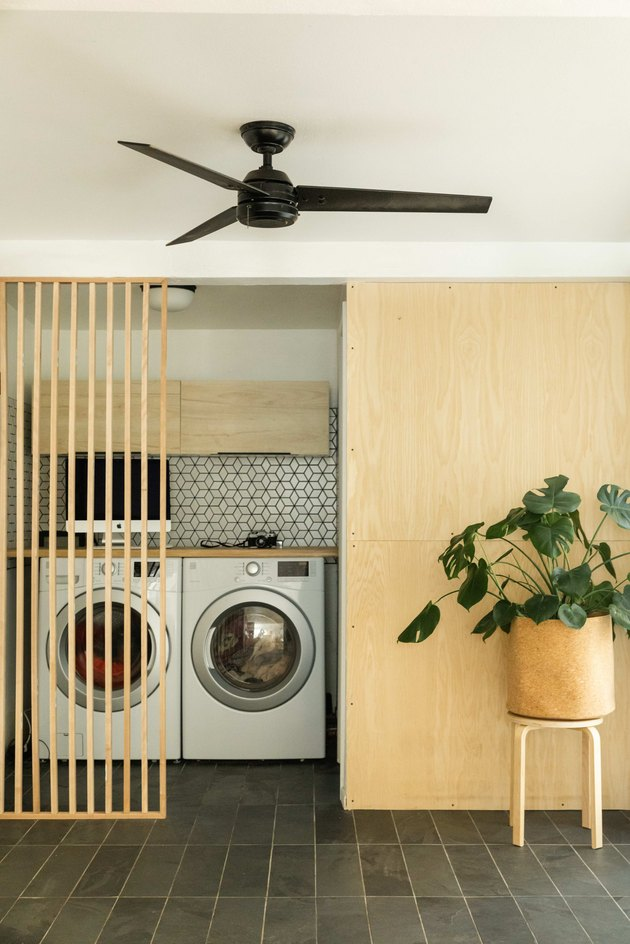 The laundry area includes birch plywood walls added to bring some warmth to the decor.