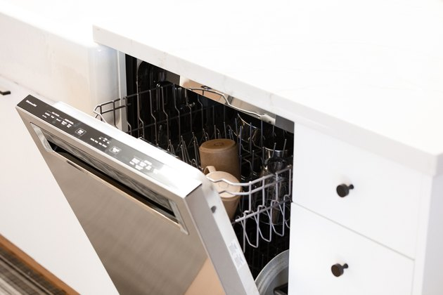 open dishwasher with two cups on top rack