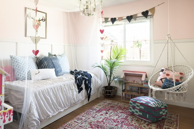 Pink kids' bedroom idea with daybed and feminine touches