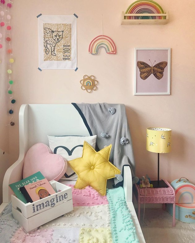 pink walls in kids bedroom idea gallery wall and playful pillows