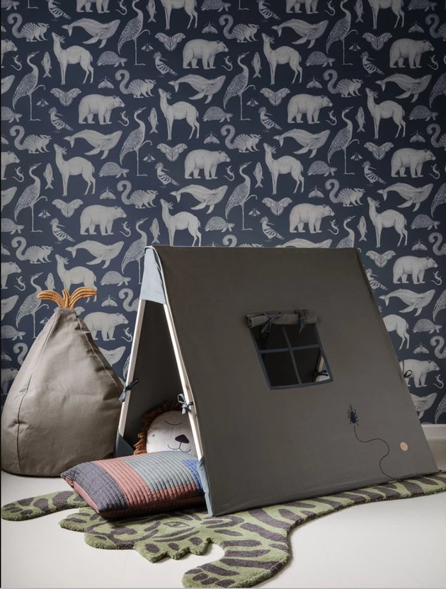 playroom decor with tiger rug and animal print wallpaper