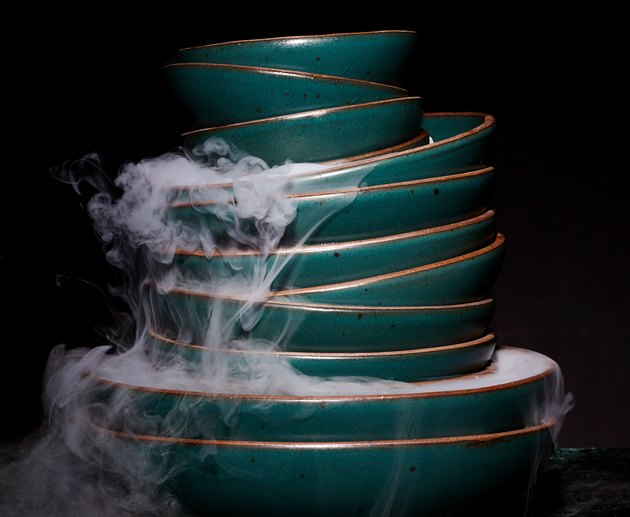 stack of plates with smoke