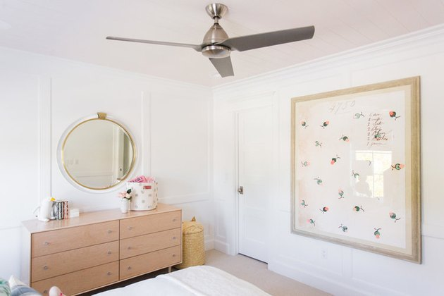pink tongue-and-groove ceiling in kids bedroom idea with oversize artwork