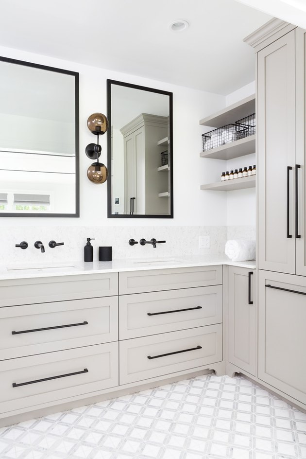 silver gray vanity cabinet with white walls and black accents
