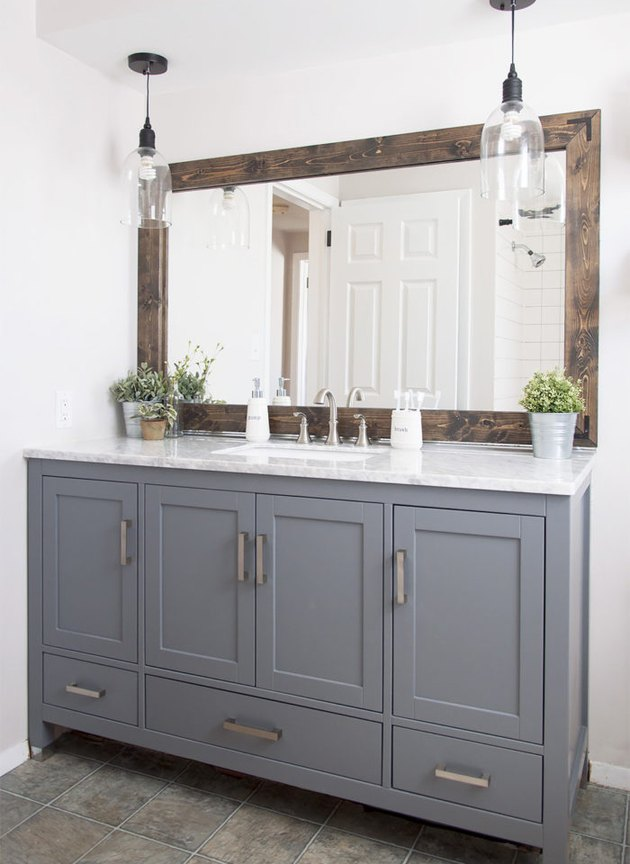industrial farmhouse bathroom with gray vanity cabinet