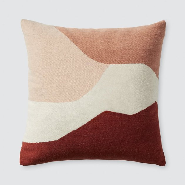 multicolored pink pillow