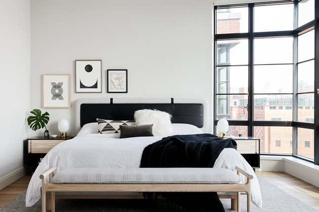 A white bedroom with black accents