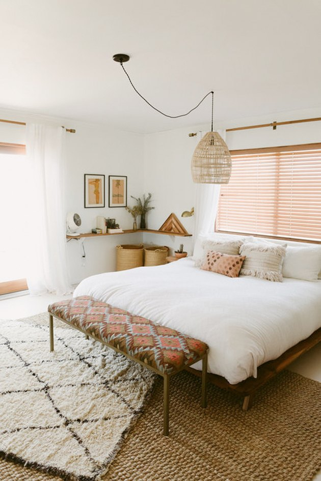 Muted patterns and natural elements in a white room