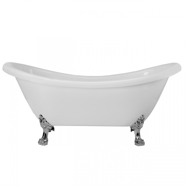 White clawfoot bathtub with nickel feet