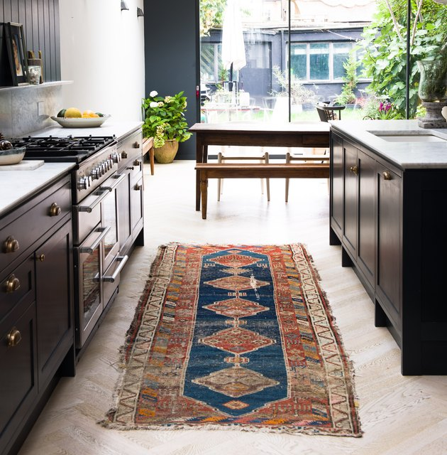 kitchen space with patterned vintage runner