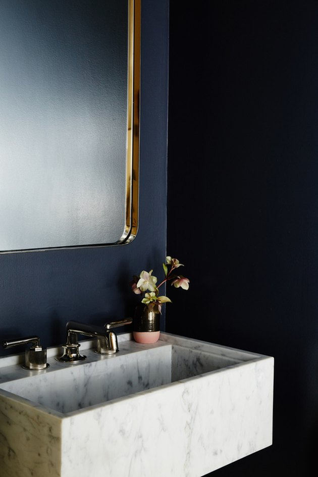 blue bathroom with wall mount marble sink