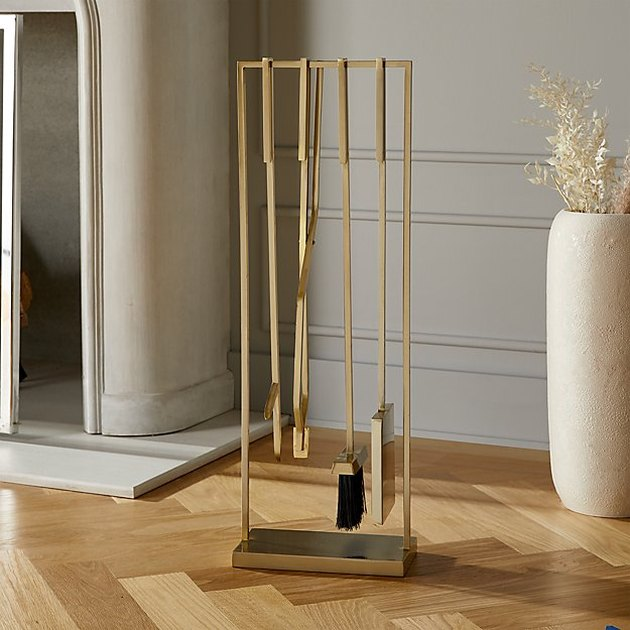 CB2 Four-Piece Gold Fireplace Set, $199