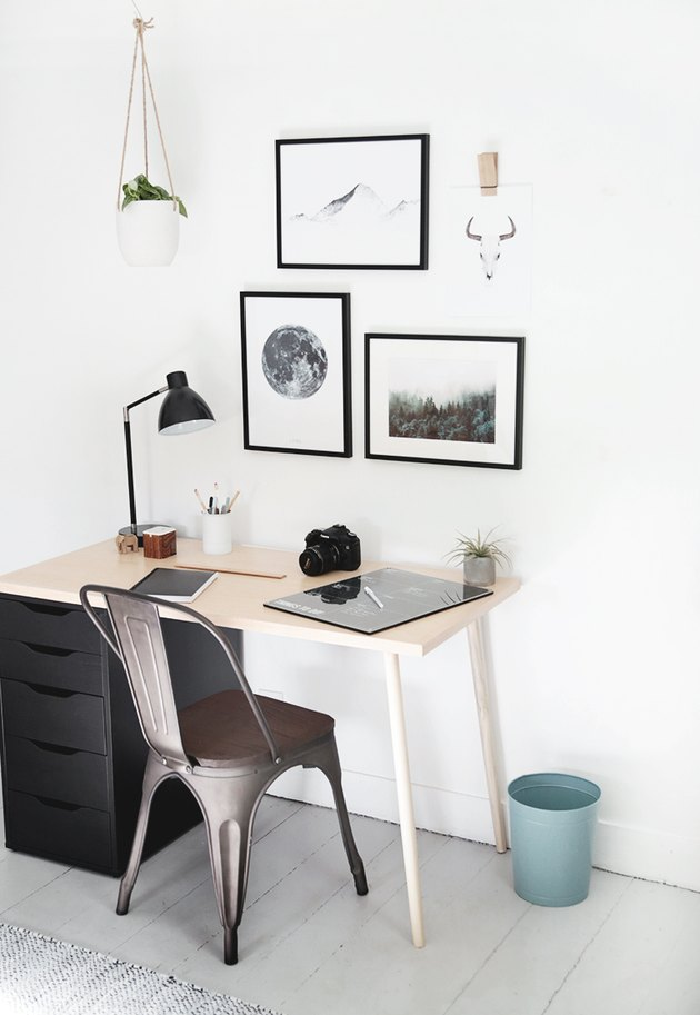 Kids' bedroom desk with minimal decor and black and white wall art