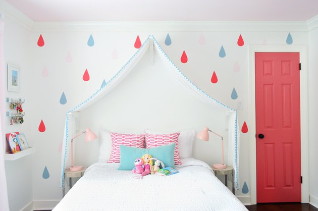 modern kids bedroom idea with pink closet door and bed canopy