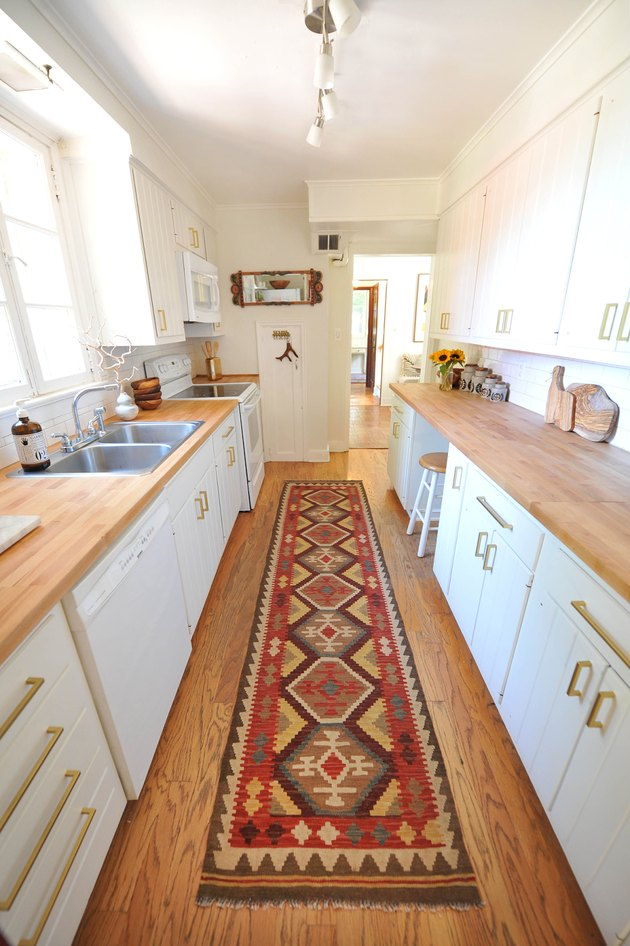 galley kitchen with wood flooring and countertops