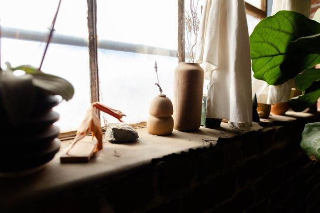 shelf with ceramic and cork pieces