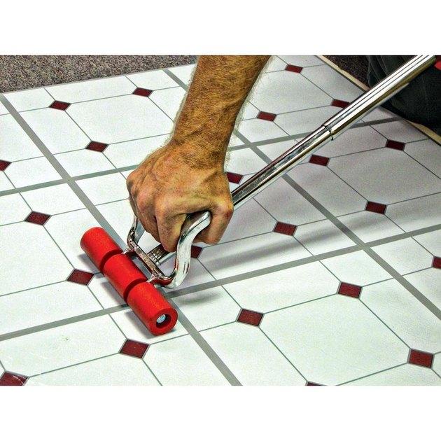 flooring roller on vinyl tile