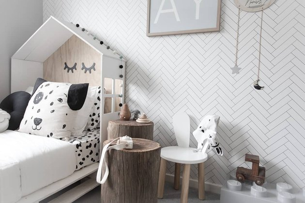 modern kids bedroom idea with herringbone wallpaper and black and white color palette