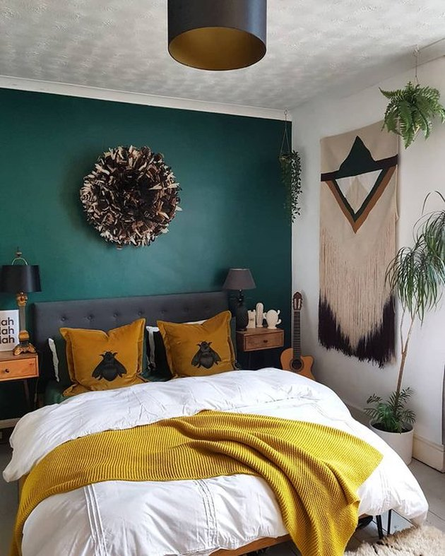 bedroom with green accent wall