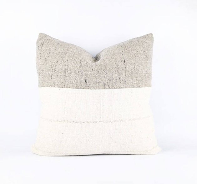 White square throw pillow with thick greige accent stripe
