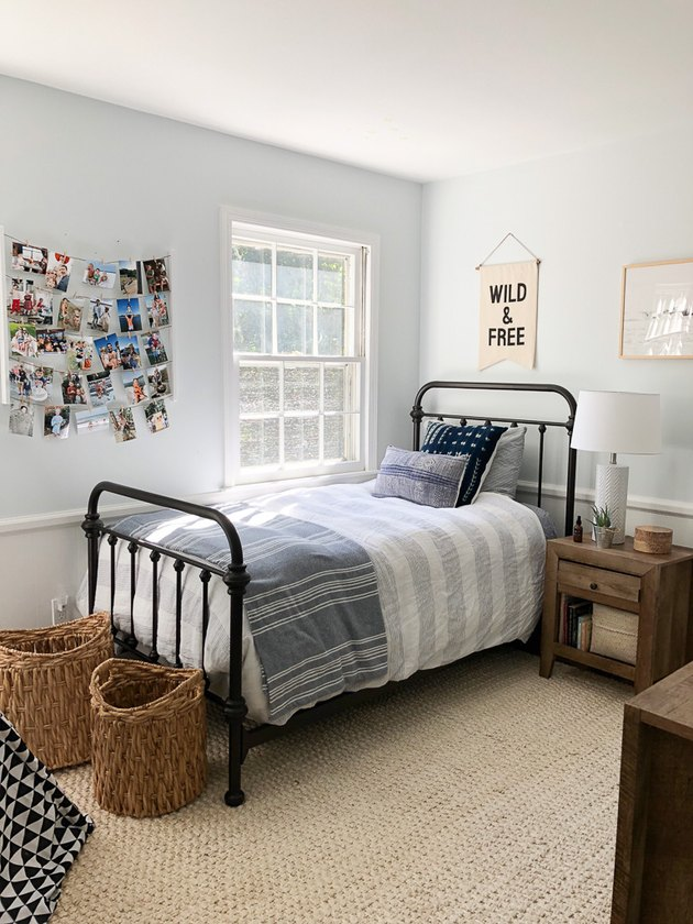 coastal boys bedroom idea with woven baskets and jute rug