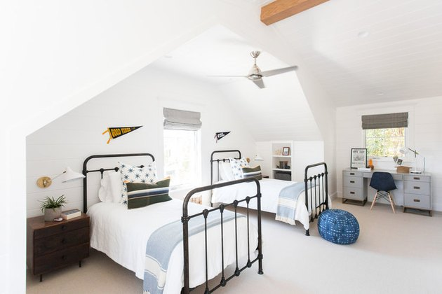 white shiplap walls in neutral boys bedroom idea with matching twin beds