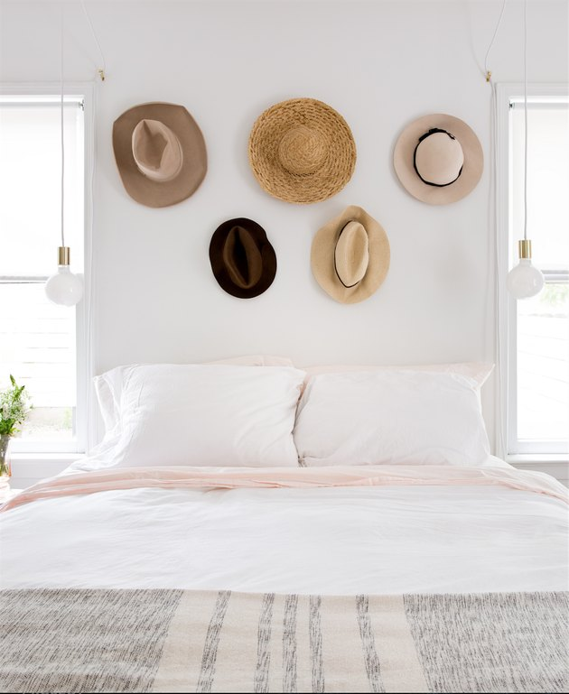 teen bedroom idea with hats displayed on wall above bed