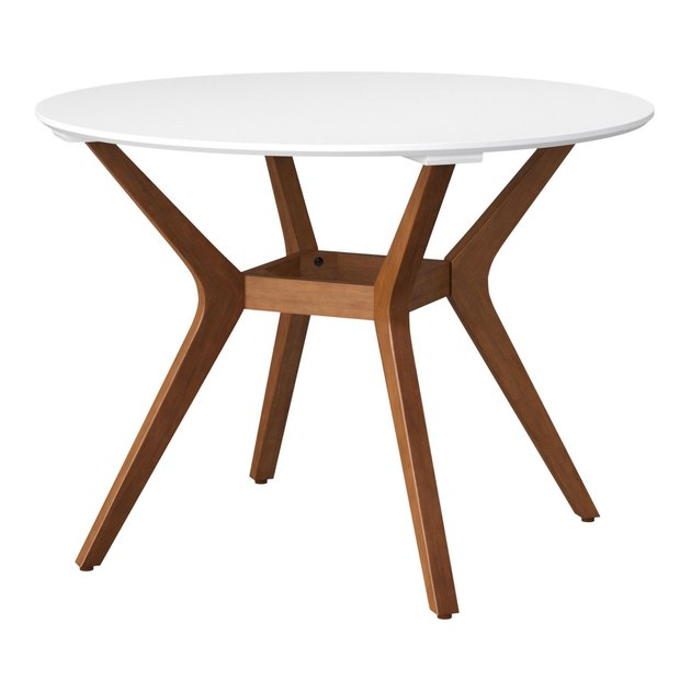 white round table with wood legs