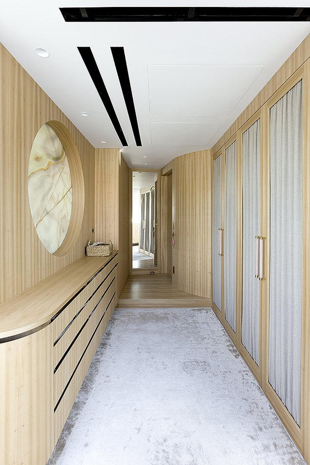 narrow hallway with wood built ins