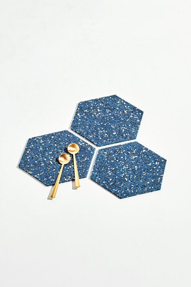 three blue speckled trivets