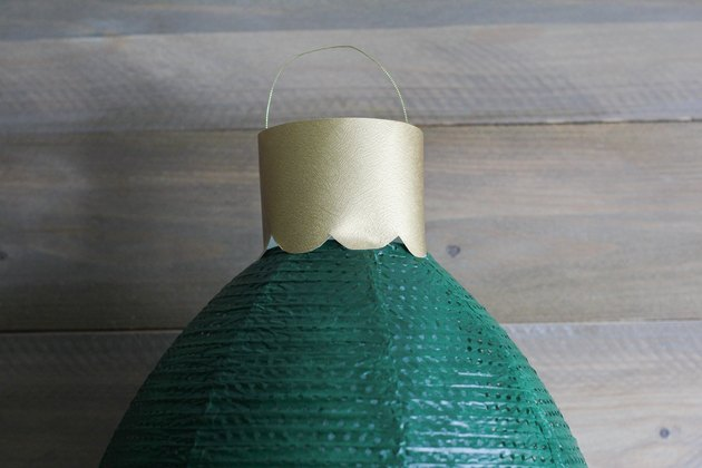 Top hook of ornament glued to top of ornament