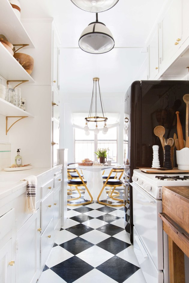 black and white galley kitchen with open shelving