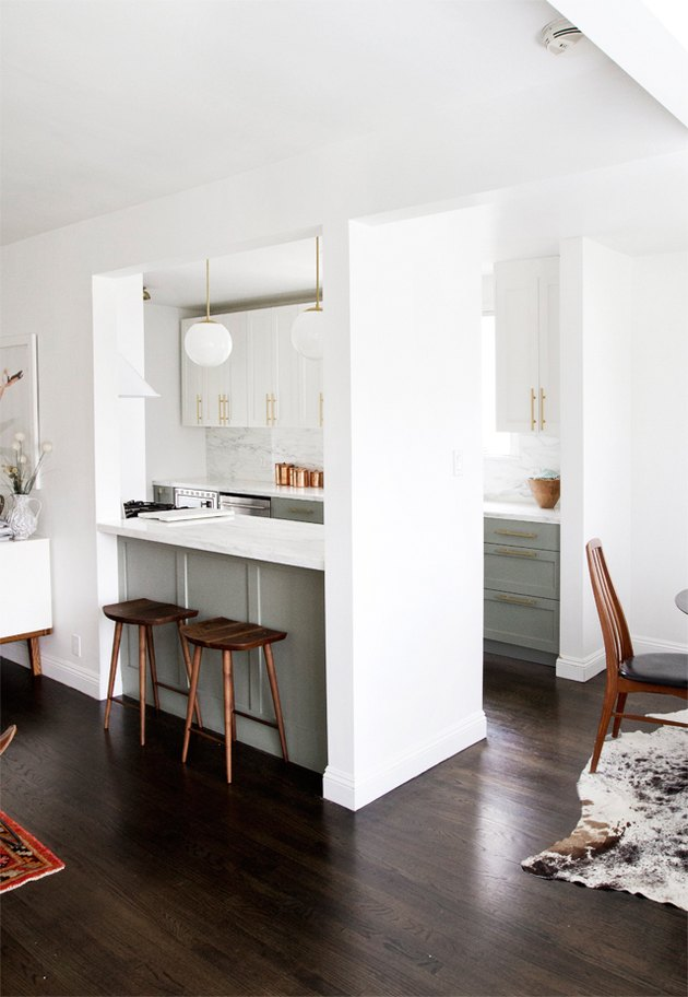 galley kitchen with green cabinets