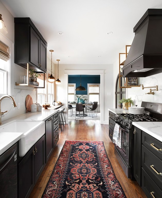 galley shaped kitchen in black with kilim runner