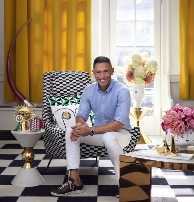 photo of jonathan adler sitting on a checkered chair