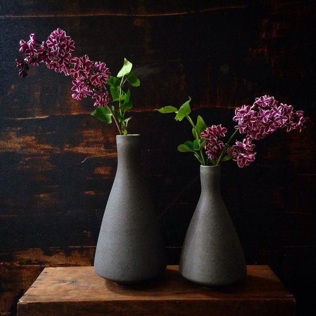 two black stoneware vases with flowers