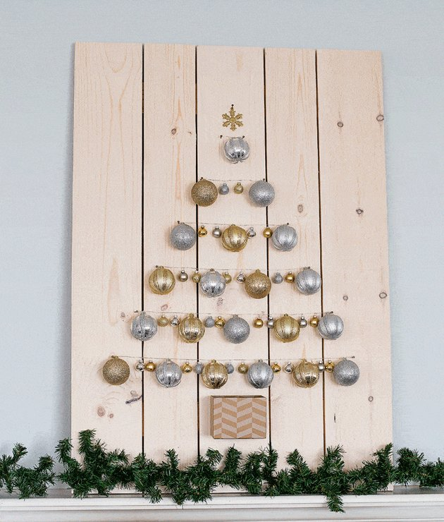Christmas tree made out of silver and gold ornaments