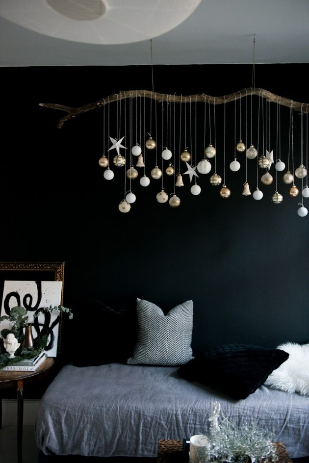 DIY branch with hanging gold and silver ornaments