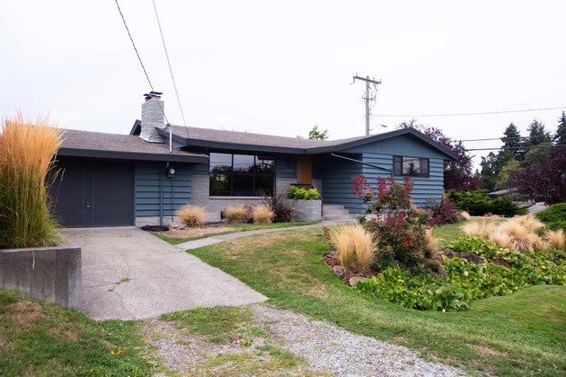 Exterior of home painted blue with dark painted garage door