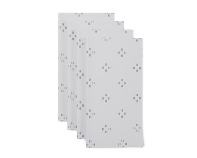 four patterned gray napkins