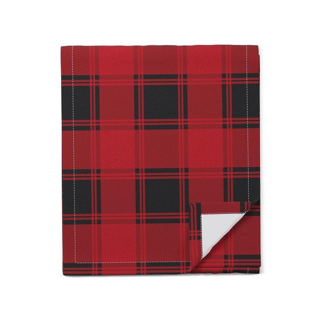 A Red tartan fabric table runner from The Inside's new tabletop collection.