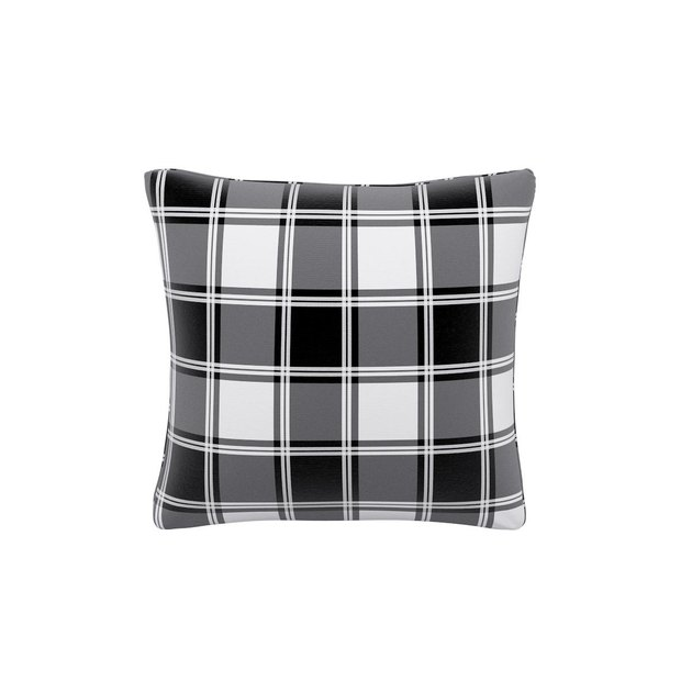A pillow from The Inside in White Tartan from their new holiday collection.