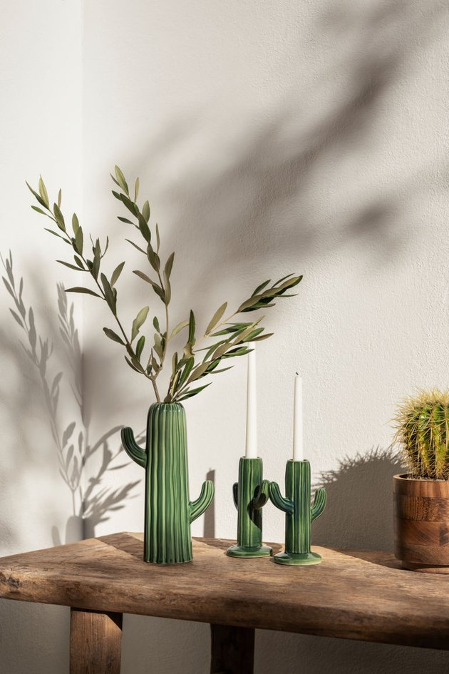 ceramic cactus-shaped pot and two candlesticks