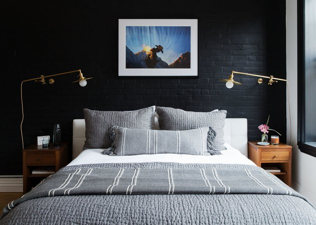 bedroom with black brick accent wall