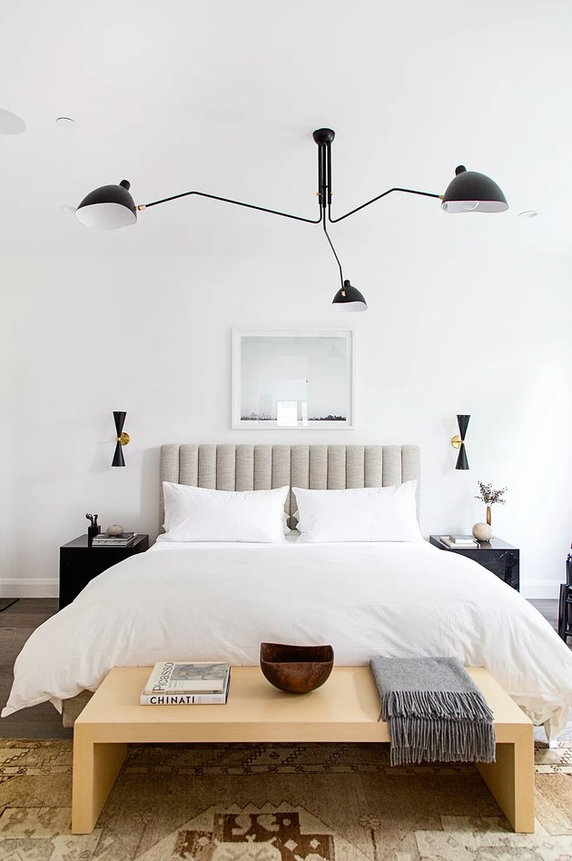 contemporary bedroom with modern chandelier