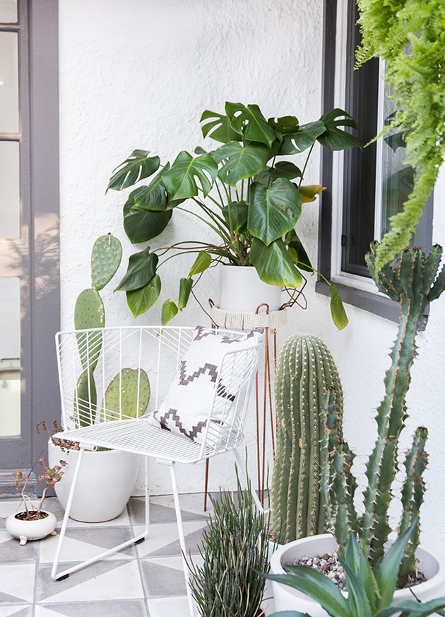 Nook small patio ideas with white decor and outdoor plants